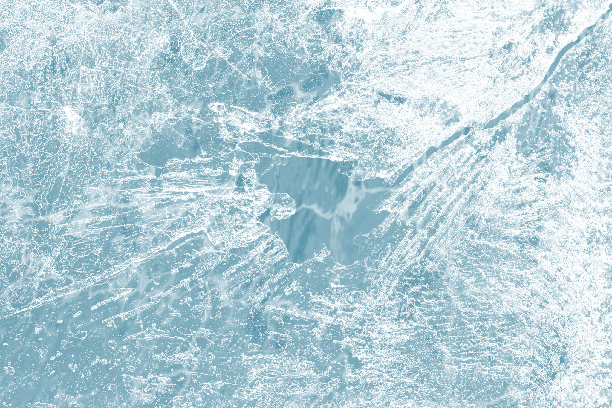 Ice surface texture macro shot on a blue backgrond wallpaper